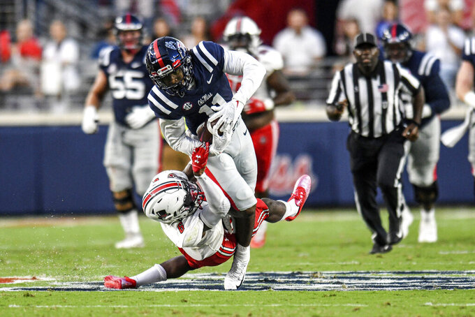 Mississippi wide receiver Dontario Drummond (11) is tackled by Austin Peay safety Kory Chapman (6) during an NCAA college football game in Oxford, Miss., Saturday, Sept. 11, 2021. (AP Photo/Bruce Newman)