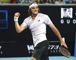 Stefanos Tsitsipas of Greece reacts after defeating Italy's Salvatore Caruso in their first round singles match at the Australian Open tennis championship in Melbourne, Australia, Monday, Jan. 20, 2020. (AP Photo/Dita Alangkara)