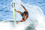 France's Michel Bourez goes airborne as he rides a wave during a training session at the 2020 Summer Olympics, Friday, July 23, 2021, at Tsurigasaki beach in Ichinomiya, Japan. (AP Photo/Francisco Seco)