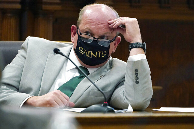State Sen. Brice Wiggins, R-Pascagoula, shows his support of the New Orleans Saints football team while wearing a face mask at a Senate Education Committee meeting with the State Superintendent of the Mississippi Department of Education Carey Wright at the Capitol in Jackson, Miss., Jan. 6, 2021. Lawmakers were generally masked throughout the hearing, removing or loosing the mask to speak clearly. (AP Photo/Rogelio V. Solis)