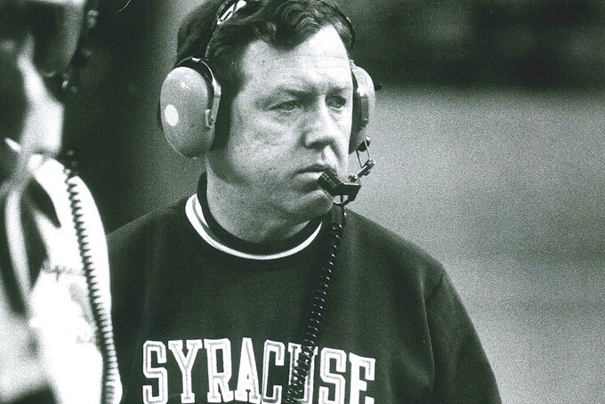 In this November 1980 photo, Syracuse University football coach Frank Maloney is shown. Former Syracuse University head football coach Frank Maloney, who succeeded the winningest coach in school history when the program was in decline, has died. He was 79. Maloney died Monday, March 30, 2020, at his home in Chicago, his family confirmed to the university. The cause was metastic brain cancer, according to Syracuse.com. (John Berry/The Post-Standard via AP)