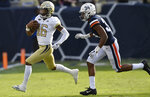 Georgia Tech quarterback TaQuon Marshall (16) runs out of the pocket against Virginia cornerback Bryce Hall (34) during the first half of an NCAA football game, Saturday, Nov. 17, 2018, in Atlanta. (AP Photo/Mike Stewart)