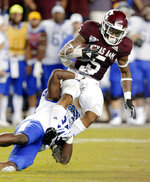 Texas A&M running back Trayveon Williams (5) is tackled by Kentucky safety Darius West during the second half of an NCAA college football game Saturday, Oct. 6, 2018, in College Station, Texas. (AP Photo/Michael Wyke)