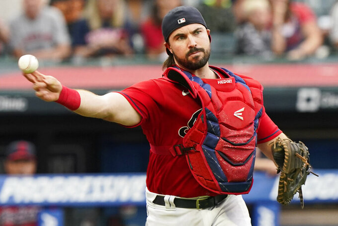 Cleveland Indians catcher Austin Hedges throws out Tampa Bay Rays' Austin Meadows at first base after a dropped third strike during the third inning of a baseball game, Thursday, July 22, 2021, in Cleveland. (AP Photo/Tony Dejak)