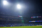 Philadelphia Phillies' Jean Segura hits an RBI-sacrifice fly off Pittsburgh Pirates pitcher Connor Overton during the third inning of a baseball game, Thursday, Sept. 23, 2021, in Philadelphia. (AP Photo/Matt Slocum)