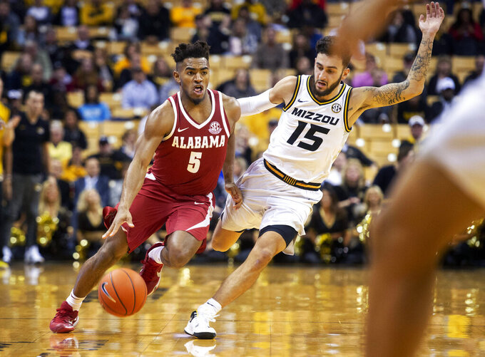 Alabama's Avery Johnson Jr., left, dribbles past Missouri's Jordan Geist, right, during the second half of an NCAA college basketball game, Wednesday, Jan. 16, 2019, in Columbia, Mo. Alabama won 70-60. (AP Photo/L.G. Patterson)