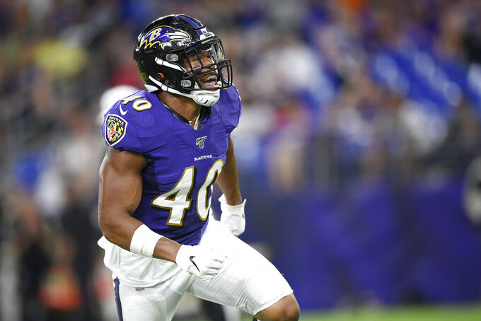 Baltimore Ravens inside linebacker Kenny Young celebrates after sacking Jacksonville Jaguars quarterback Gardner Minshew during the first half of an NFL football preseason game Thursday, Aug. 8, 2019, in Baltimore. (AP Photo/Nick Wass)