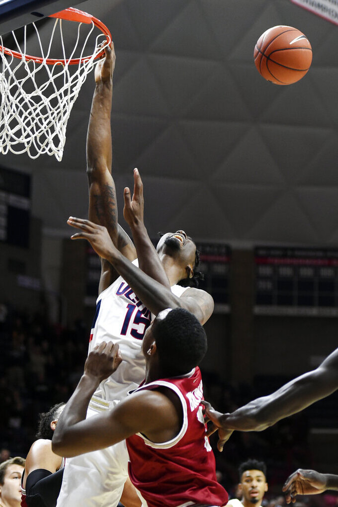 Connecticut's Sidney Wilson (15) misses his shot against Saint Joseph's guard Cameron Brown (3) in the first half of an NCAA college basketball game Wednesday, Nov. 13, 2019, in Storrs, Conn. (AP Photo/Stephen Dunn)