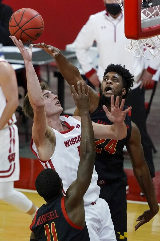 Wisconsin's Tyler Wahl shoots between Maryland's Darryl Morsell (11) and Donta Scott (24) during the second half of an NCAA college basketball game Monday, Dec. 28, 2020, in Madison, Wis. (AP Photo/Morry Gash)