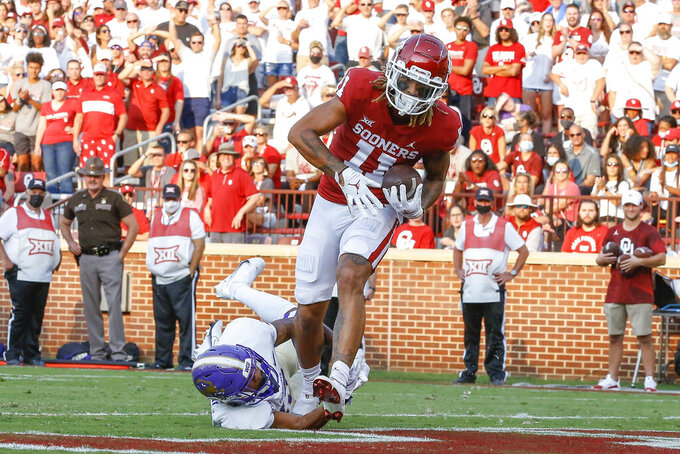 Oklahoma wide receiver Jadon Haselwood (11) scores a touchdown during the first half of the team's NCAA college football game against Western Carolina on Saturday, Sept. 11, 2021, in Norman, Okla. (AP Photo/Alonzo Adams)