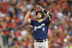Milwaukee Brewers' Ryan Braun gestures near first after he hit a single during the third inning of the team's baseball game against the Washington Nationals, Saturday, Aug. 17, 2019, in Washington. (AP Photo/Nick Wass)
