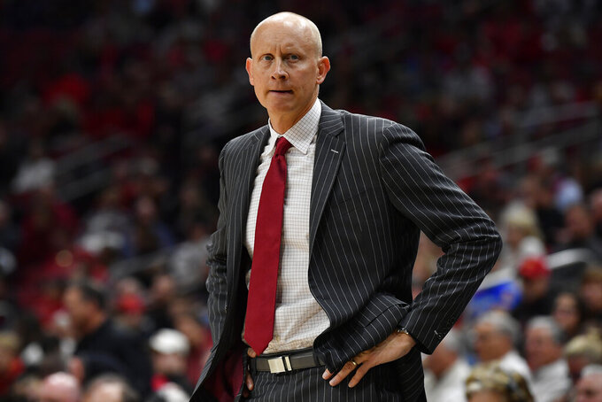 Louisville head coach Chris Mack watches his team during the second half of an NCAA college basketball game in Louisville, Ky., Wednesday, Nov. 20, 2019. Louisville won 76-50. (AP Photo/Timothy D. Easley)