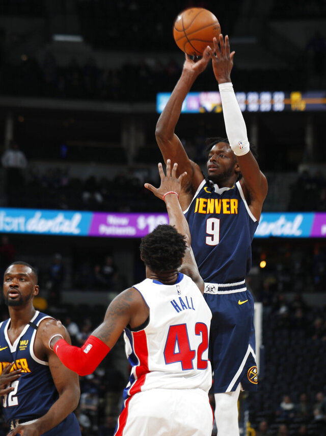 Denver Nuggets forward Jerami Grant, back, shoots over Detroit Pistons center Donta Hall late in the second half of an NBA basketball game Tuesday, Feb. 25, 2020, in Denver. The Nuggets won 115-98. (AP Photo/David Zalubowski)