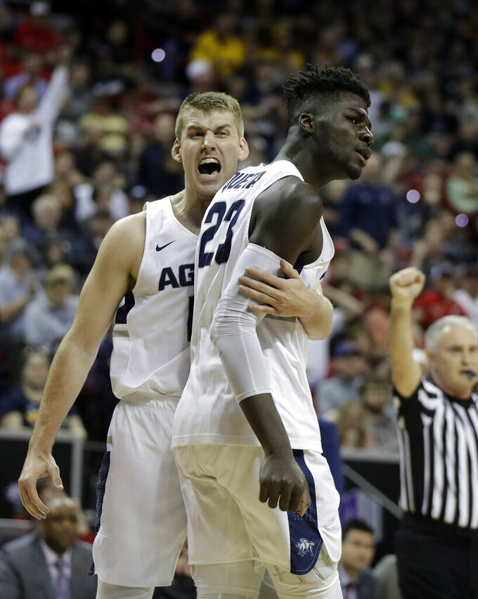 Utah State's Quinn Taylor, left, and Neemias Queta react after a foul call during the first half of an NCAA college basketball game against San Diego State in the Mountain West Conference men's tournament championship Saturday, March 16, 2019, in Las Vegas. (AP Photo/Isaac Brekken)