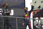 First place Red Bull driver Max Verstappen of the Netherlands, right, and third place Mercedes driver Lewis Hamilton of Britain, left, stand on the podium after the Formula One Grand Prix at the Spa-Francorchamps racetrack in Spa, Belgium, Sunday, Aug. 29, 2021. The race was red flagged due to weather conditions. (AP Photo/Francisco Seco)