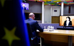 European Council President Charles Michel, left, speaks with Georgian President Salome Zurabishvili, on screen, during a video conference at the European Council building in Brussels, Monday, April 19, 2021. (Kenzo Tribouillard, Pool via AP)
