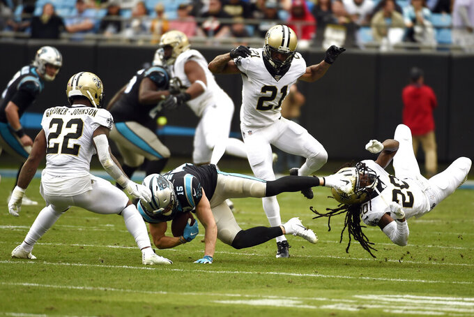 New Orleans Saints defensive back Chauncey Gardner-Johnson (22), defensive back Patrick Robinson (21) ans cornerback Janoris Jenkins (20) defend against Carolina Panthers wide receiver Chris Hogan (15) during the first half of an NFL football game in Charlotte, N.C., Sunday, Dec. 29, 2019. (AP Photo/Mike McCarn)
