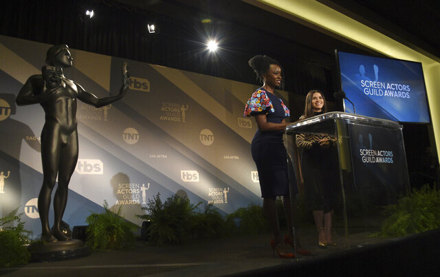 Danai Gurira, left, and America Ferrera announce nominations for the 26th annual Screen Actors Guild Awards at the Pacific Design Center on Wednesday, Dec. 11, 2019, in West Hollywood, Calif. The show will be held on Sunday, Jan. 19, 2020, in Los Angeles. (AP Photo/Chris Pizzello)
