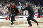 Texas Tech's Norense Odiase (32) warms up during a practice session for the semifinals of the Final Four NCAA college basketball tournament, Friday, April 5, 2019, in Minneapolis. (AP Photo/Charlie Neibergall)