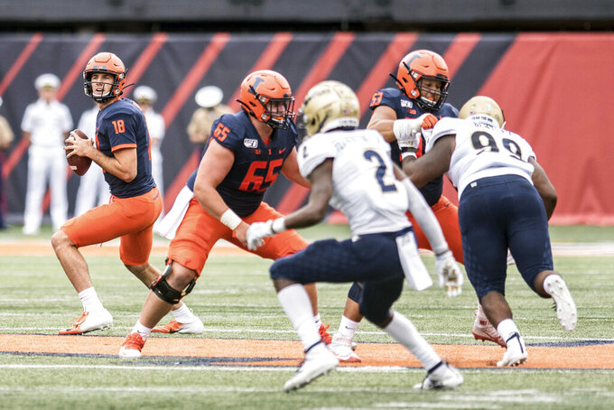 Illinois quarterback Brandon Peters (18) looks for an open receiver in the first half of an NCAA college football game against Akron, Saturday, Aug. 31, 2019, in Champaign, Ill. (AP Photo/Holly Hart)