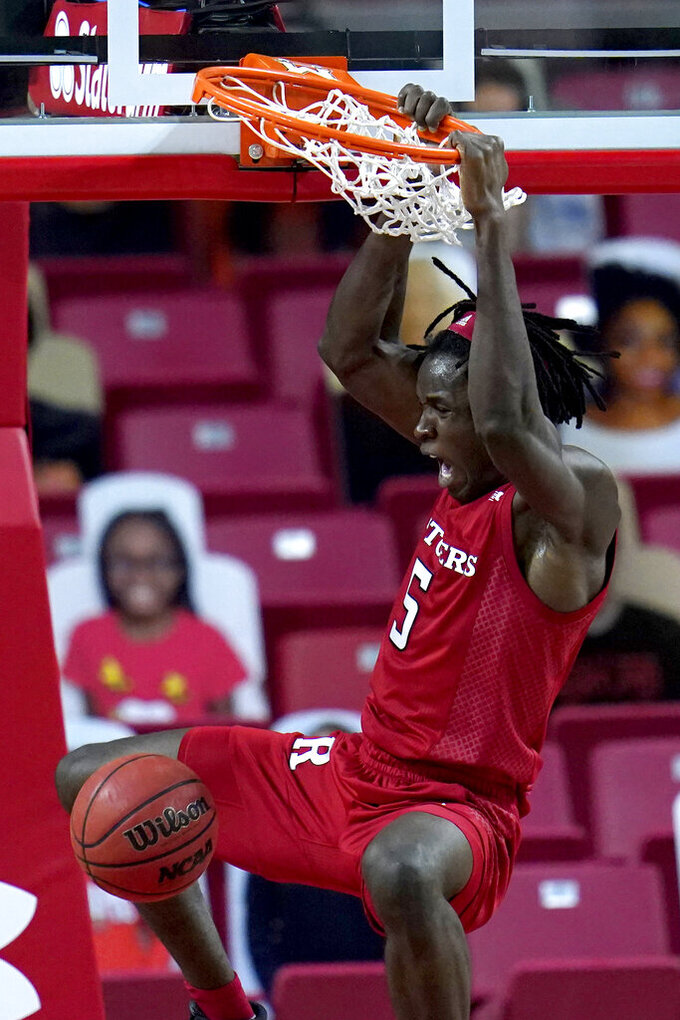 Rutgers center Cliff Omoruyi dunks on Maryland during the first half of an NCAA college basketball game, Monday, Dec. 14, 2020, in College Park, Md. (AP Photo/Julio Cortez)