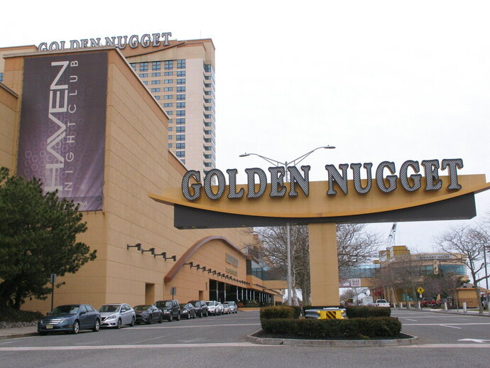 This Feb. 22, 2019, photo shows the exterior of the Golden Nugget casino in Atlantic City, N.J. New Jersey lawmakers have introduced a bill that would enable the casino to accept sports bets on NBA games that do not involve the Houston Rockets, which casino owner Tilman Fertitta also owns. The Golden Nugget is currently prohibited from taking any NBA bets because of Fertitta's ownership of the Rockets. (AP Photo/Wayne Parry)