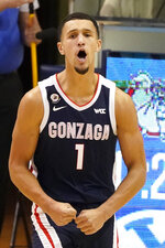 Gonzaga guard Jalen Suggs (1) reacts after scoring against BYU in the first half during an NCAA college basketball game Monday, Feb. 8, 2021, in Provo, Utah. (AP Photo/Rick Bowmer)