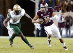 Texas A&M quarterback Kellen Mond (11) keeps the ball as UAB defensive lineman Jamell Garcia-Williams (99) chases during the first half of an NCAA college football game Saturday, Nov. 17, 2018, in College Station, Texas. (AP Photo/Michael Wyke)