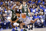 Colorado State guard Kendle Moore (3) defends Duke guard Tre Jones (3) during the first half of an NCAA college basketball game in Durham, N.C., Friday, Nov. 8, 2019. (AP Photo/Gerry Broome)