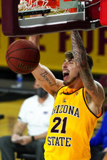 Arizona State forward Chris Osten (21) dunks against Houston Baptist during the first half of an NCAA college basketball game, Sunday, Nov. 29, 2020, in Tempe, Ariz. (AP Photo/Rick Scuteri)