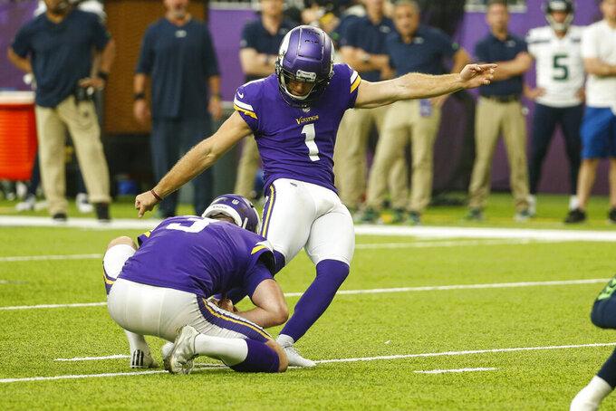 Minnesota Vikings kicker Greg Joseph (1) kicks a field goal from the hold of Jordan Berry against the Seattle Seahawks in the second half of an NFL football game in Minneapolis, Sunday, Sept. 26, 2021. (AP Photo/Bruce Kluckhohn)