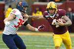 Minnesota running back Shannon Brooks (4) rushes against Illinois linebacker Jake Hansen (35) in the third quarter of an NCAA college football game Saturday, Oct. 5, 2019, in Minneapolis. (AP Photo/Bruce Kluckhohn)