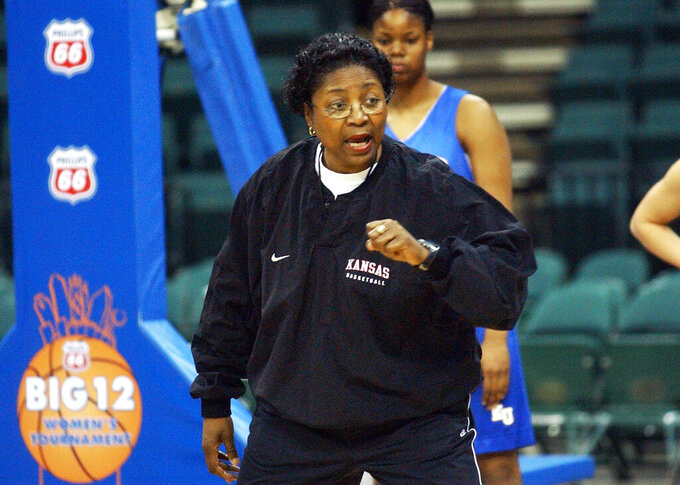 FILE - In this March 10, 2003, file photo, Kansas head coach Marian Washington talks to her players during a practice session for the Women's Big 12 basketball tournament in Dallas. The five Black women, including Washington, who have been national team assistants helped pave the way for Dawn Staley's historic debut at the Tokyo Games.  (AP Photo/Tim Sharp, File)