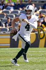 Las Vegas Raiders quarterback Derek Carr (4) looks to pass during the second half of an NFL football game against the Pittsburgh Steelers in Pittsburgh, Sunday, Sept. 19, 2021. (AP Photo/Keith Srakocic)