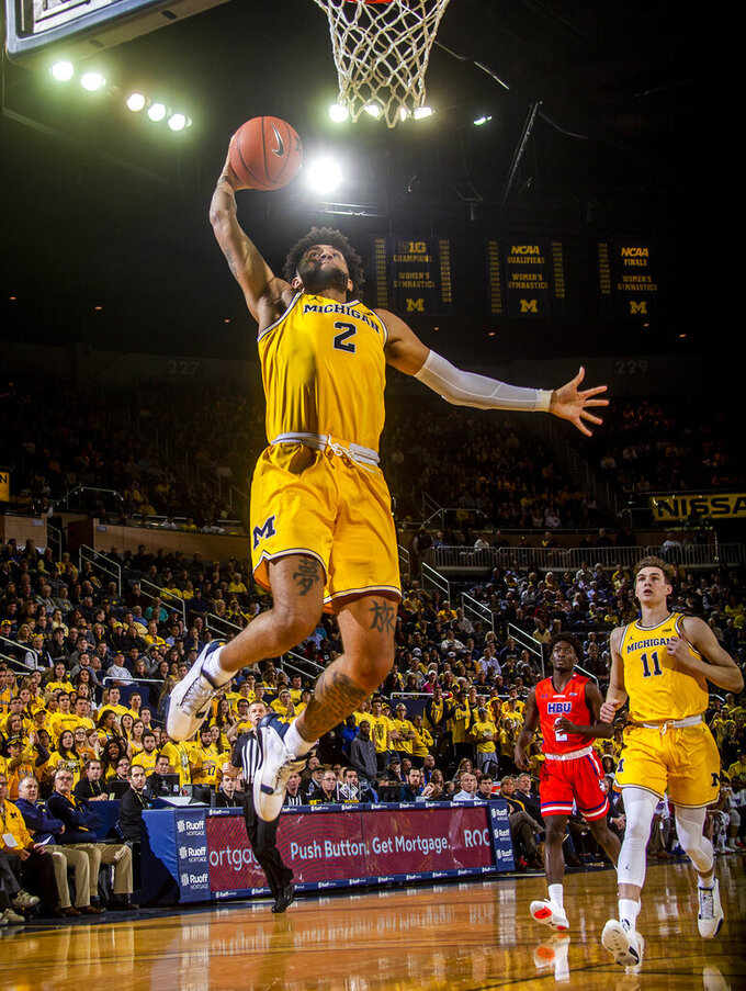 Michigan forward Isaiah Livers (2) dunks during the second half of the team's NCAA college basketball game against Houston Baptist in Ann Arbor, Mich., Friday, Nov. 22, 2019. Michigan won 111-68. (AP Photo/Tony Ding)