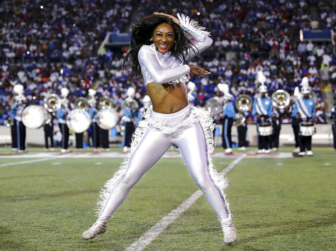 Members of the Jackson State band and dance team perform at halftime during the Southern Heritage Classic NCAA college football game against Tennessee State in Memphis, Tenn., Saturday, Sept. 11, 2021. (Patrick Lantrip/Daily Memphian via AP)