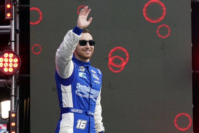Kaz Grala waves to fans during driver introductions before the NASCAR Cup Series auto race at Daytona International Speedway, Saturday, Aug. 28, 2021, in Daytona Beach, Fla. (AP Photo/John Raoux)