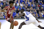 Creighton's Damien Jefferson (23) attempts to steal the ball from Oklahoma's Jamal Bieniemy (24) during the first half of an NCAA college basketball game in Omaha, Neb., Tuesday, Dec. 17, 2019. (AP Photo/Nati Harnik)