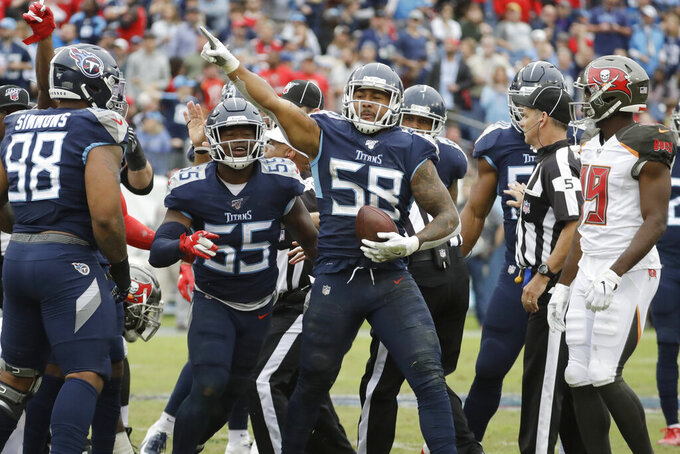 Tennessee Titans linebacker Harold Landry (58) celebrates after recovering a fumble against the Tampa Bay Buccaneers in the fourth quarter of an NFL football game Sunday, Oct. 27, 2019, in Nashville, Tenn. The Titans won 27-23. (AP Photo/James Kenney)