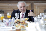 Brazil's President Michel Temer speaks during a breakfast with foreign correspondents in the presidential residence in Brasilia, Brazil, Thursday, Dec. 6, 2018. Temer says he is not