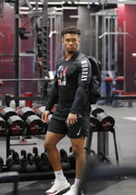 Oklahoma quarterback Kyler Murray arrives at the university's Pro Day for NFL scouts in Norman, Okla., Wednesday, March 13, 2019. (AP Photo/Alonzo Adams)