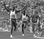 FILE - In this Sept. 4, 1972 file photo, Kipchoge Keino of Kenya raises his arms in triumph as he wins the final of the Olympic games 3,000-meter steeplechase event ahead of Benjamin Jipcho (574), another Kenyan, at the Munich Olympic Stadium, Germany. Running great Kip Keino has handed himself over to police and is under arrest following allegations he and six other Kenyan sports and government officials embezzled and misappropriated more than $545,000 set aside for their team at the 2016 Rio de Janeiro Olympics. Keino, former sports minister Hassan Wario and two other former sports ministry officials surrendered to police Thursday and are due in court Friday to plead to charges of corruption and abuse of office. (AP Photo, File)