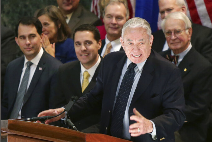 FILE - In this Jan. 31, 2017, file photo, former Wisconsin Gov. Tommy Thompson speaks at the State Capitol in Madison, Wis.  The University of Wisconsin System regents' leader has selected Thompson on Friday, June 19, 2020, to serve as the system's interim president. Thompson will take over on July 1. He will replace outgoing President Ray Cross, who announced in October he would step down when a successor was found. (Michael P. King/Wisconsin State Journal via AP, File)