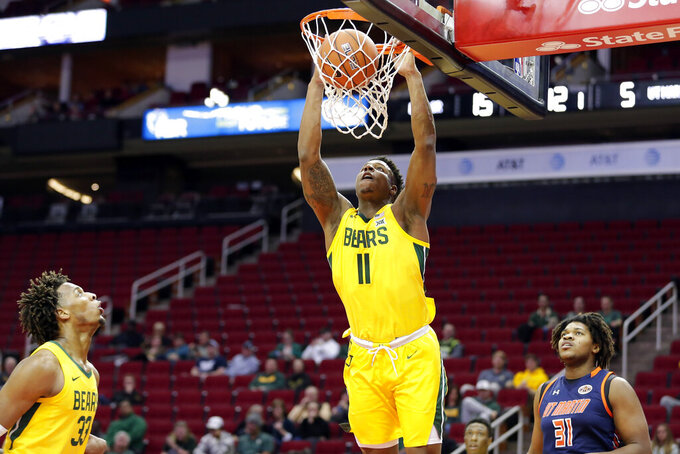 Baylor guard Mark Vital (11) dunks as forward Freddie Gillespie (33) and Tennessee-Martin center Jordan Pierce (31) watch during the first half of an NCAA college basketball game Wednesday, Dec. 18, 2019, in Houston. (AP Photo/Michael Wyke)