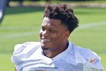 FILE - Miami Dolphins' Ereck Flowers looks on between drills during NFL football practice in Davie, Fla., in this Friday, Sept. 11, 2020, file photo. The Miami Dolphins agreed to trade veteran guard Ereck Flowers to Washington in a deal Tuesday, April 27, 2021, that also included a swap of late-round draft picks. The Dolphins will pay Flowers $6 million as a signing bonus for a restructured contract this year, and Washington will pay him a $3 million base salary, said his agent, Drew Rosenhaus. (AP Photo/Joel Auerbach, File)