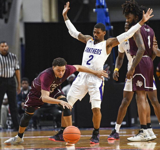Texas Southern guard Jalyn Patterson (3) runs into Prairie View A&M guard Darius Williams (2) during the second half of the SWAC championship basketball game Saturday, March 16, 2019, in Birmingham, Ala. (AP Photo/Julie Bennett)