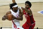 Toronto Raptors' Precious Achiuwa, left, drives against Houston Rockets' Josh Christopher during the first half of an NBA summer league basketball game Thursday, Aug. 12, 2021, in Las Vegas. (AP Photo/John Locher)