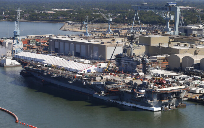 """FILE - This April 27, 2016, file photo, shows the nuclear powered aircraft carrier USS Abraham Lincoln at Newport News Shipbuilding in Newport News, Va. The U.S. is dispatching the USS Abraham Lincoln and other military resources to the Middle East following """"clear indications"""" that Iran and its proxy forces were preparing to possibly attack U.S. forces in the region, according to a defense official on May 5, 2019. (AP Photo/Steve Helber, File)"""