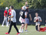 Ohio State head coach Ryan Day watches the quarterbacks during NCAA college football practice, Friday, Aug. 2, 2019, in Columbus, Ohio. (AP Photo/Jay LaPrete)