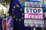 An anti Brexit demonstrators banner near Parliament in London, Tuesday, Oct. 22, 2019.British lawmakers from across the political spectrum were plotting Tuesday to put the brakes on Prime Minister Boris Johnson's drive to push his European Union divorce bill through the House of Commons in just three days, potentially scuttling the government's hopes of delivering Brexit by Oct. 31.(AP Photo/Kirsty Wigglesworth)
